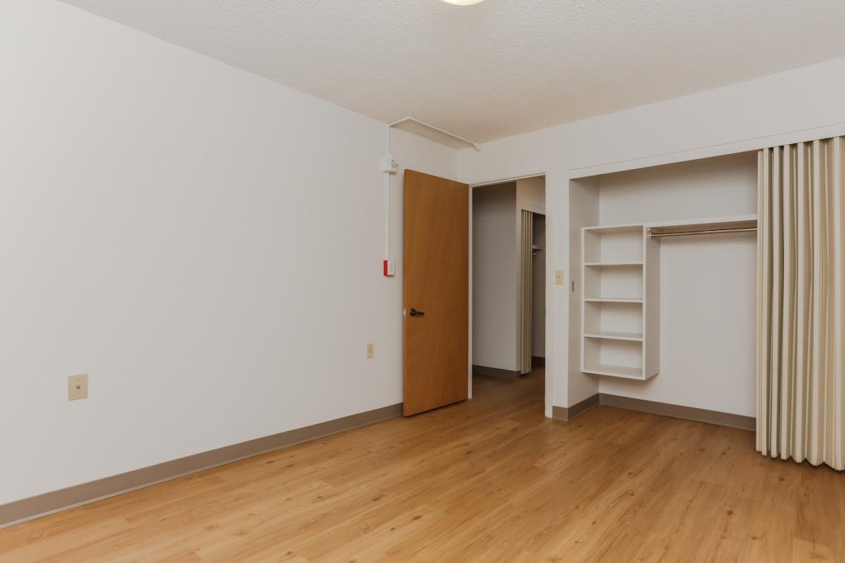 One bedroom suite bedroom with closet
